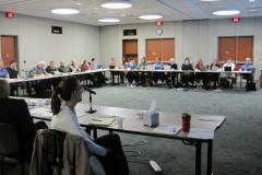 Alliance members listening to presentation
